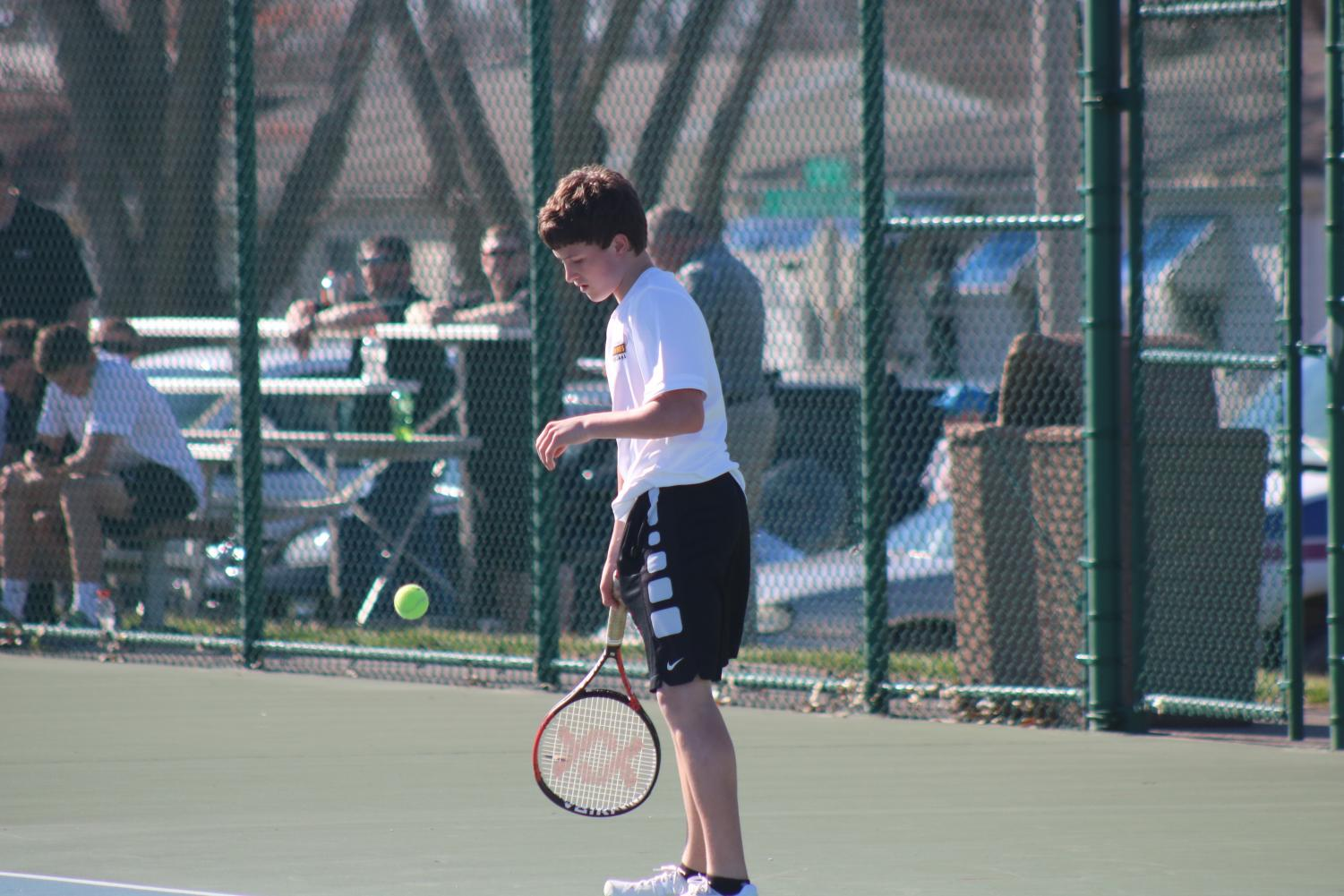 Sophomore Grant Sturm takes a breath before serving to his opponent. This is Sturm's first year playing tennis. He is undefeated in the #6 spot thus far, after topping challengers from Kuemper Catholic, Shenandoah, and Glenwood.