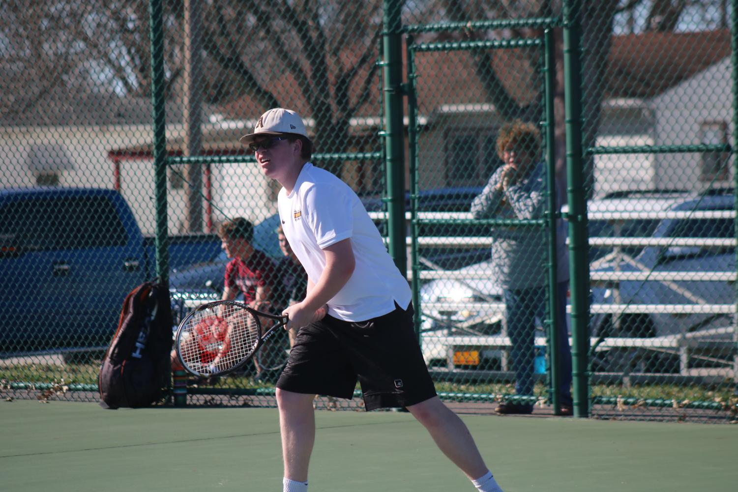 Senior Avery Andersen stands ready to return the ball. Andersen has won two singles matches so far this season, against Glenwood and Creston. This is his first year suiting varsity.