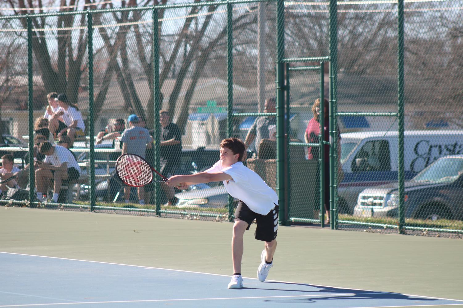 Sophomore Grant Sturm eyes his backhand shot earlier this season. Sturm started the season as a new player, and he has moved his way up to the #5 varsity spot.