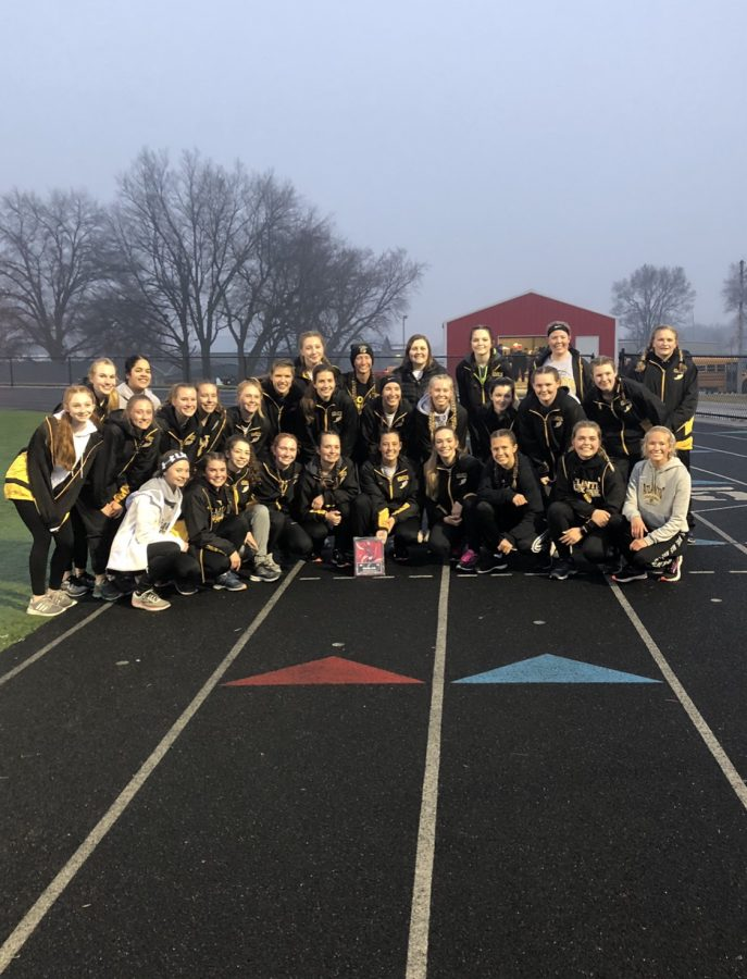 THE+FACE+OF+A+WINNER+-+Trojan+girls+pose+on+the+track+after+their+second+win+of+the+season.+The+girls+also+won+the+Koos+relays+in+Harlan.