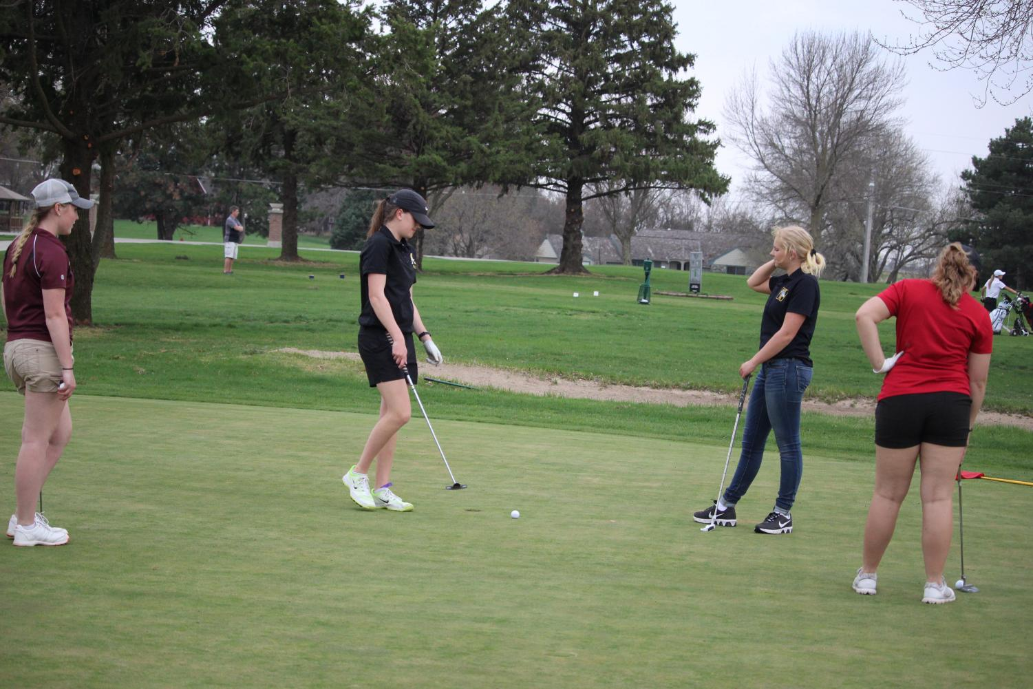 Sophomore Anna Wieser putts the ball on the green. This is Wieser's second year in golf.