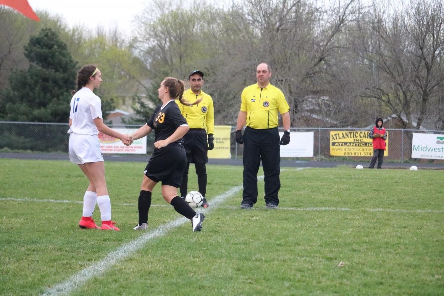 Sophomore Tatum Grubbs shakes hands with a member of the other team.