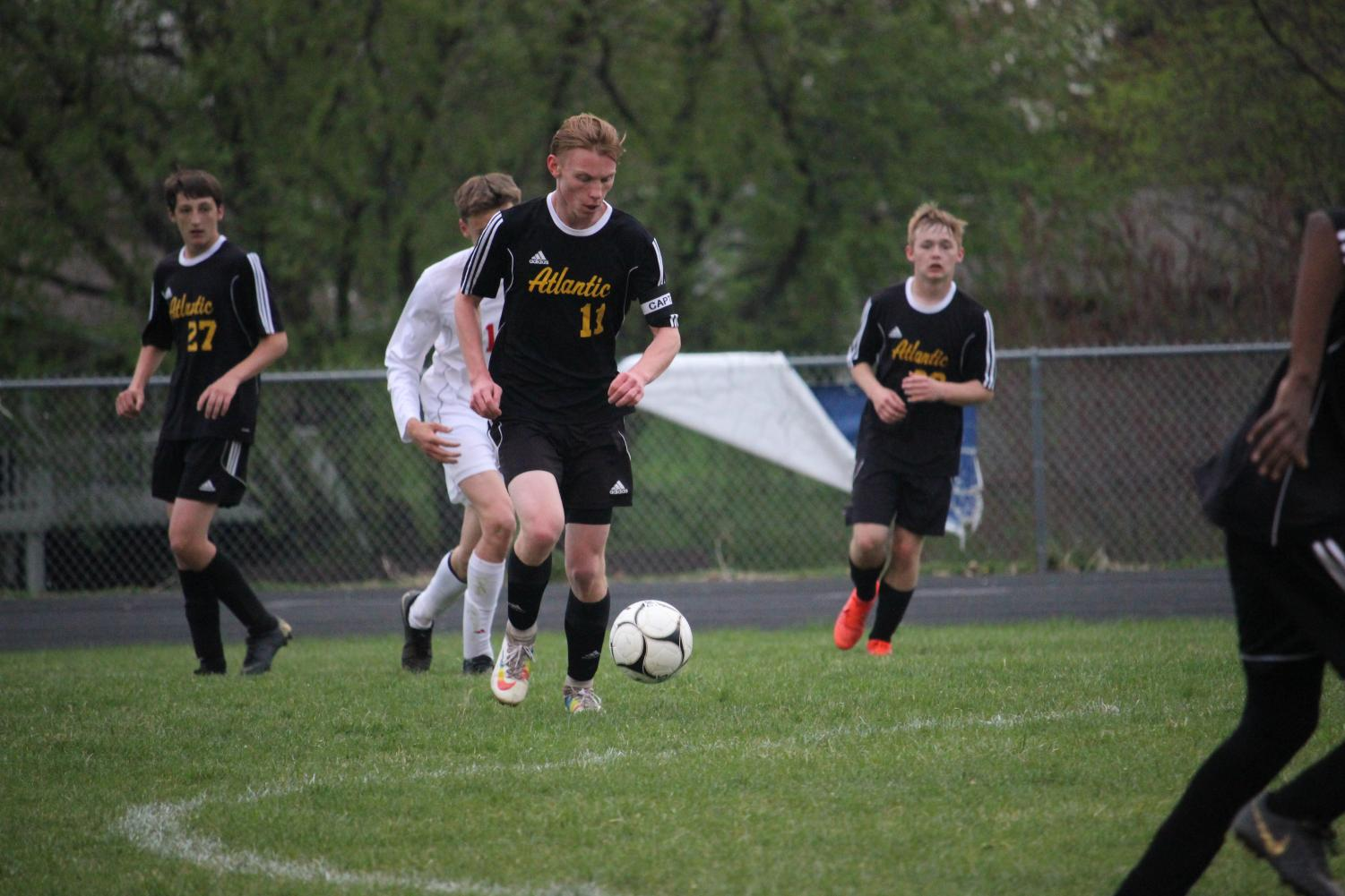 OFFENSIVE MINDSET - Junior Ben Andersen dribbles the ball upfield in the matchup against the Harlan Cyclones. Andersen had a total of four shots in the three games during the week of April 22.
