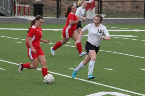 Junior Katie Saluk defends the goal against a Missouri Valley Lady Red. Saluk has been involved in soccer for three years.