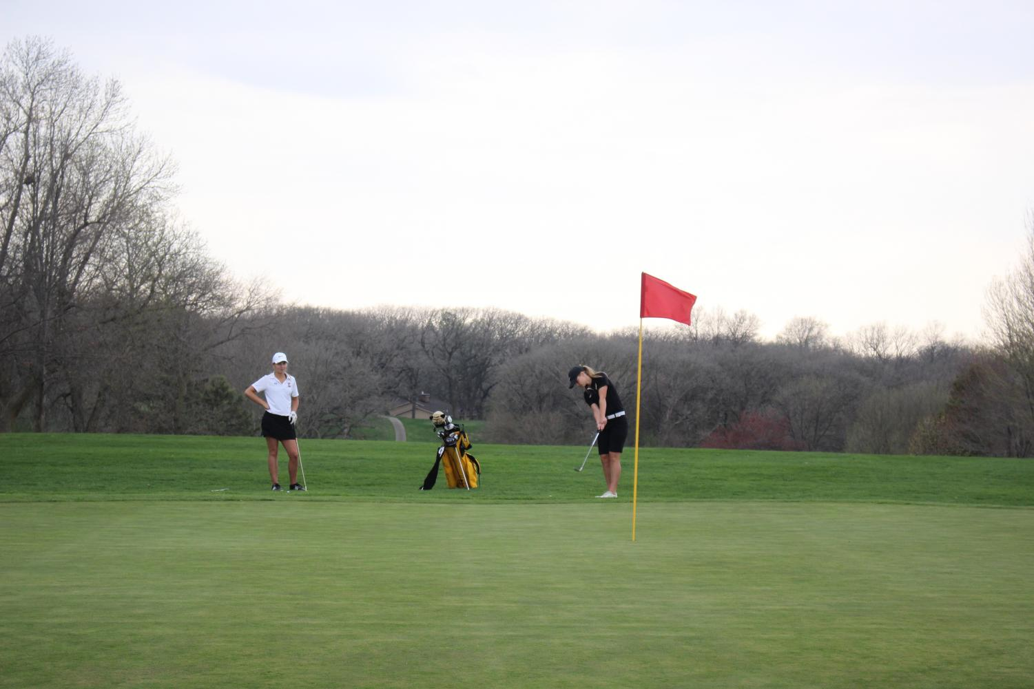 Senior Alyssa Ginther eyes her putt at the Atlantic Golf and Country Club. Against Glenwood, Ginther shot a 41, tying teammate Baylee Newell.