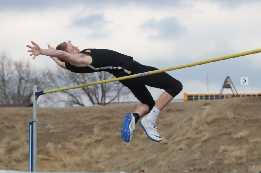 FLYING+HIGH+-+Junior+Spencer+Ray+makes+another+attempt+during+the+high+jump+event+at+the+Denison+track+meet.+Ray+qualified+for+the+state+meet+in+high+jump+during+the+2018+season.