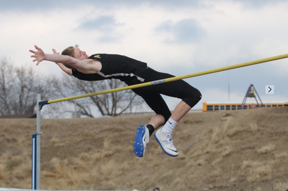 FLYING HIGH - Junior Spencer Ray makes another attempt during the high jump event at the Denison track meet. Ray qualified for the state meet in high jump during the 2018 season.