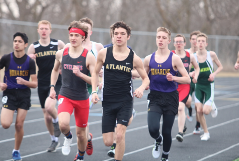 INCHING AWAY -  Senior Jalen Petersen creeps into the lead position during the 3200m run at the Denison meet. Petersen took first during that race and again in Harlan.