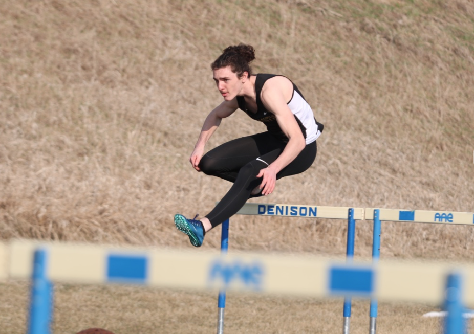 UP AND OVER - Sophomore Colin Mullinex sprints his leg of the shuttle hurdle relay event. Mullinex was joined by senior Connor Pellet, sophomore Joe Weaver and freshman Kadin Stutzman.