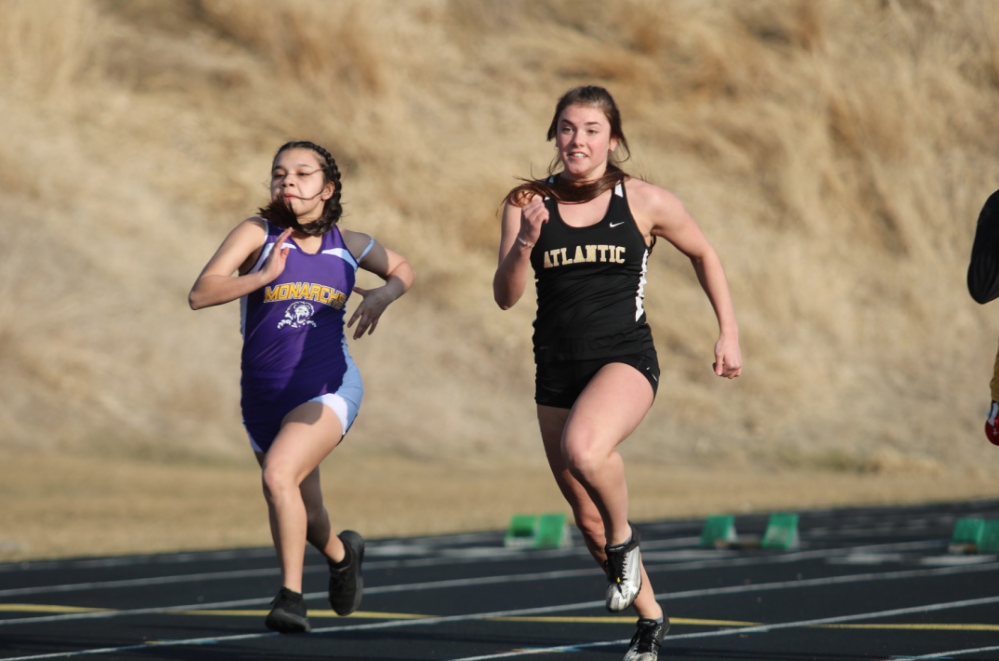 NECK AND NECK - Junior Aleigh Bean inches ahead of her opponent as she flies to the finish. Bean has been involved with Track & Field since her freshman year.