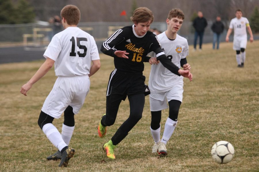 TAKING CHARGE - Senior Nathan Brockman sprints for the ball during the matchup against the Tri-Center Trojans. Brockman is a captain for the team this year.