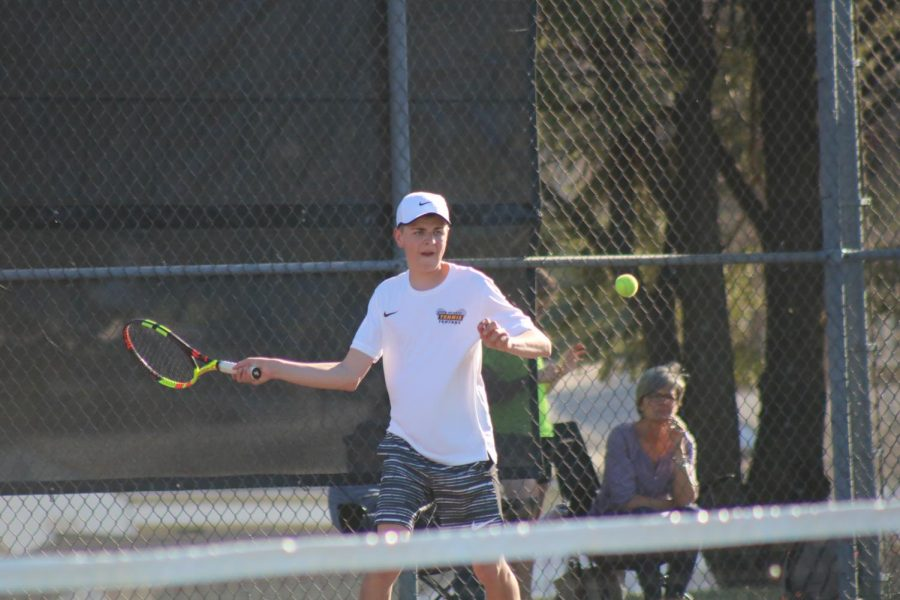Junior+Jesse+Reid+prepares+to+hit+a+forehand+to+his+competitor+in+the+%232+singles+match.+Reid+has+played+tennis+all+three+years+of+high+school.+