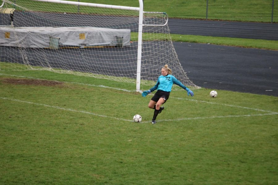 Junior+Corri+Pelzer+boots+the+ball+during+a+goal+kick.+Pelzer+is+the+Varsity+goalie+this+year.