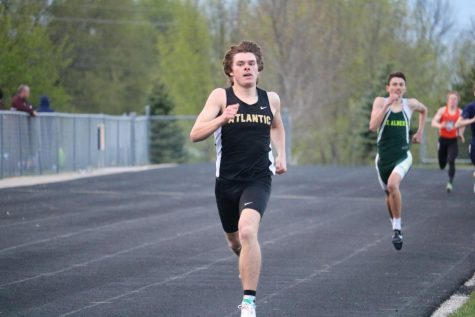 DOWN THE HOME STRETCH - Senior Chase Mullenix strides down the straightaway at the co-ed home track meet. Mullenix qualified in several events for the state meet.