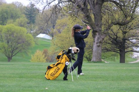 Senior Alyssa Ginther swats the ball at a home meet. At the home tournament, Ginther placed second.