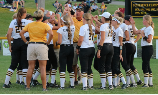 The Trojan softball team breaks down before a game last season. In 2018, their record was 30-7, which included a state berth.