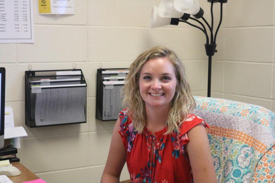 Sarah Elm smiles from her office in the guidance wing. Elm is also the sponsor of student council.