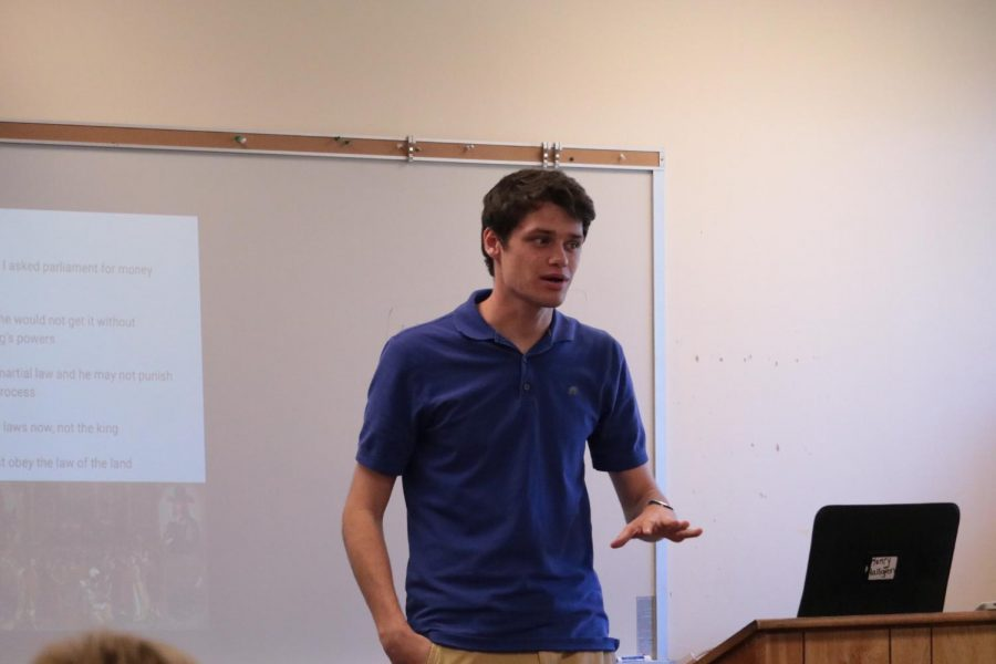 Henry Hallgren explains the content of his presentation to his students. Hallgren is a first year teacher.