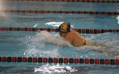 Trojan Girls Swim Rallies Against CB Abraham Lincoln
