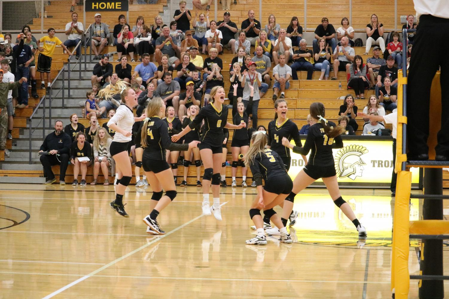 The Trojan volleyball team celebrates on Thursday against the Cyclones. So far this season, Atlantic has won 17 total sets.