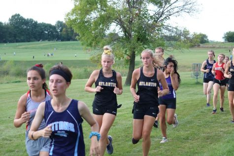 Freshmen Dana Dreager and Edria Brummer focus on finishing. Both runners tear up the JV circuit.