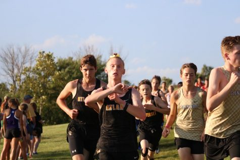 Seniors Clayton Jipsen and Ben Andersen compete a recent meet. Both boys tear up the JV course.