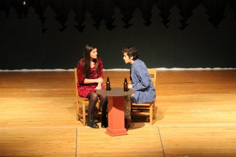 Junior Genevieve Martinez and sophomore Nolan Perez chat during a scene in last year's play. Both students auditioned for