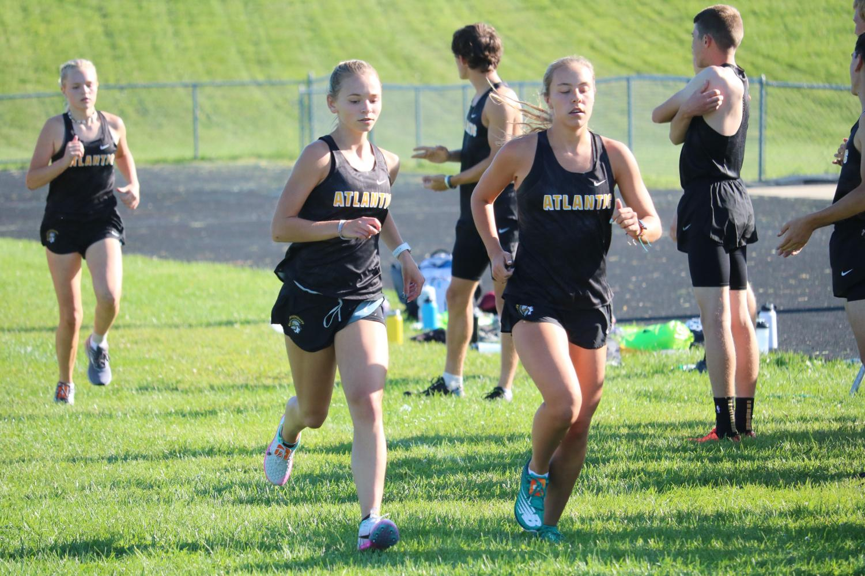 Senior Pluma Pross and sophomore Addie DeArment run neck and neck while freshman Claire Weirderstein trails behind.