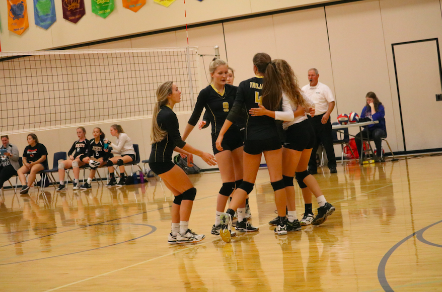 The+volleyball+team+chats+after+an+exciting+point+last+season.+Currently%2C+Atlantic%27s+record+is+4-8.