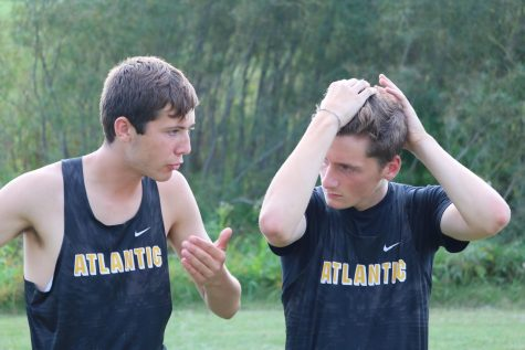 THE END OF AN ERA -- Seniors Clayton Jipsen and Zach McKay are deep in conversation. Both have been involved with cross country since their freshman year.