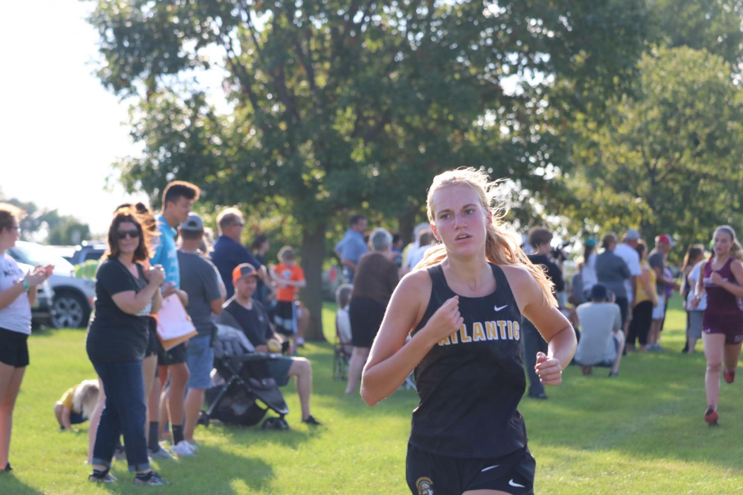 Junior Madison Botos is running hard. She finished 68th on Thursday.