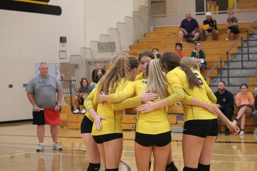 The volleyball girls come together for a pregame huddle. The girls had 67 kills between the two matches on Tuesday night.