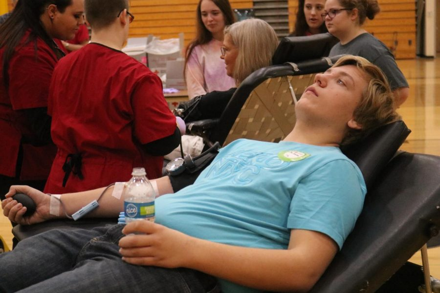 Senior Joel Behrens gives blood at the last blood drive. Behrens plans to donate at this drive as well.