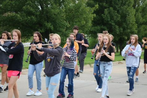 The Trojan Guard practices parade marching outside. They will preform in multiple parades this fall.