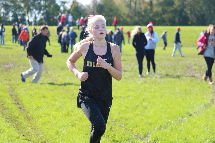 Claire Wiederstein spots the finish line at the home meet. Wiederstein finished 34th at the conference meet.