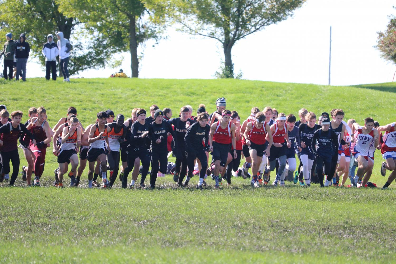 The varsity boys' team starts the race at the home meet this past Saturday. The boys earned sixth place, and the girls finished in seventh.