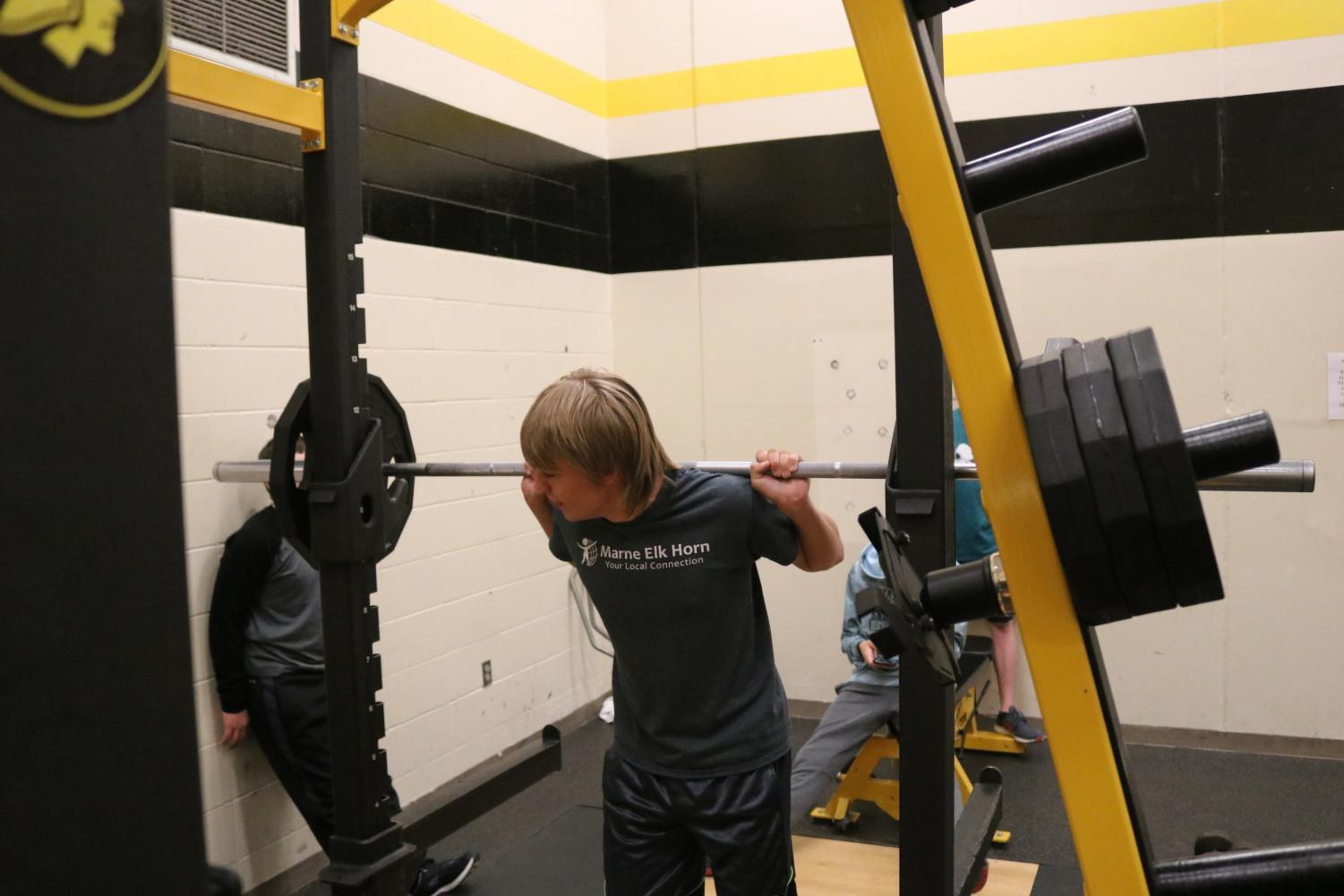 Junior Devin Wood pumps the iron in weights class. Wood is a part of the cross country and soccer teams.