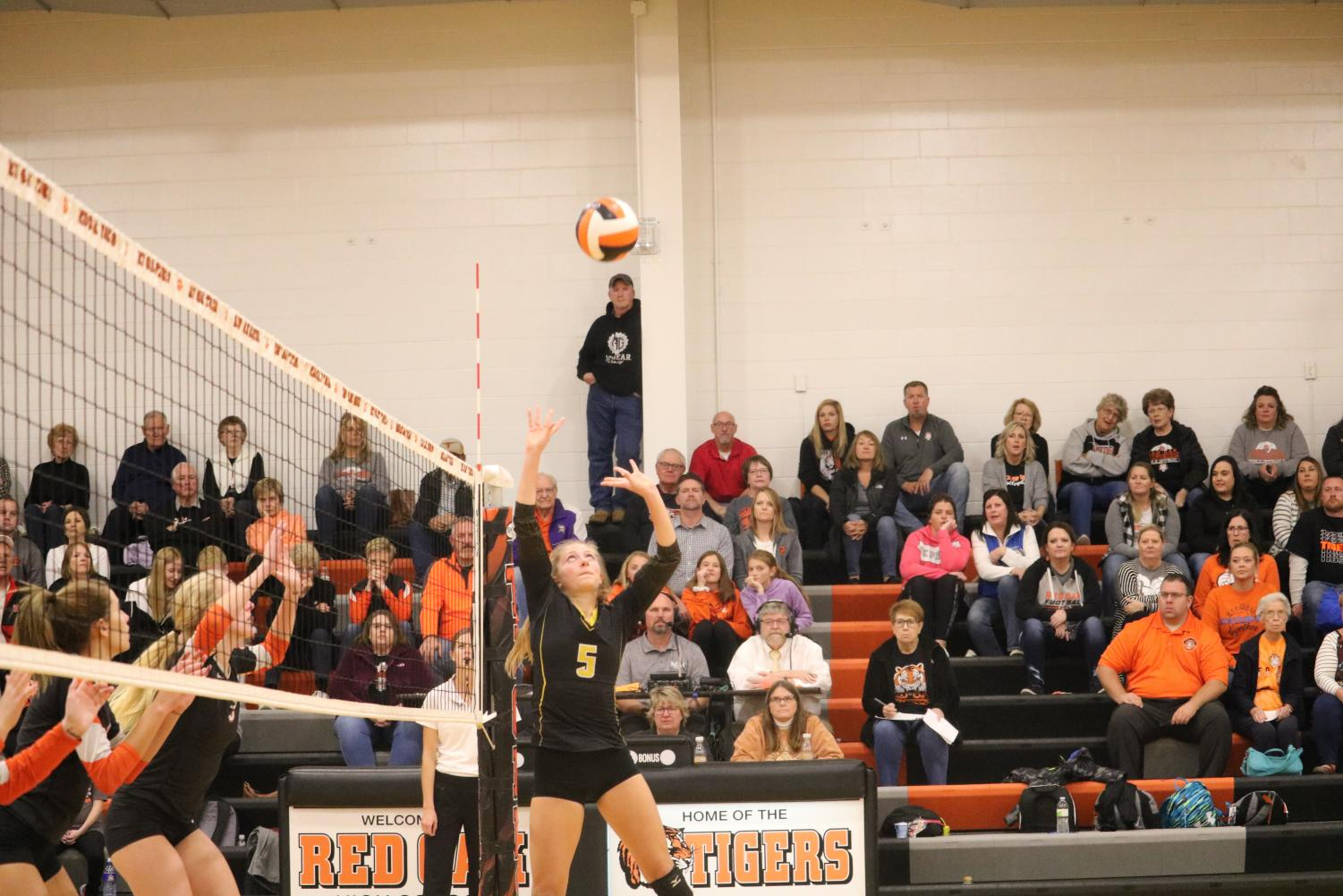 Junior Haley Rasmussen sets the ball in the final match of the season against Red Oak. Rasmussen totaled 580 assists on the season.