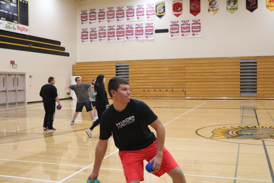 Freshman+Daniel+Freund+prepares+to+chuck+a+dodgeball+at+his+classmate.++Dodgeball+isn%27t+a+unit+in+gym%2C+but+it+is+often+played.
