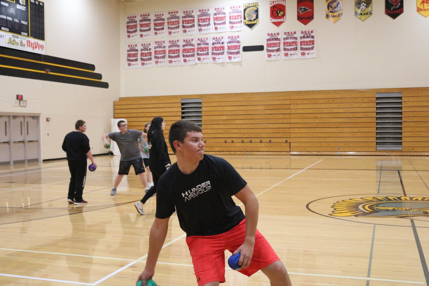 Freshman Daniel Freund prepares to chuck a dodgeball at his classmate.  Dodgeball isn't a unit in gym, but it is often played.