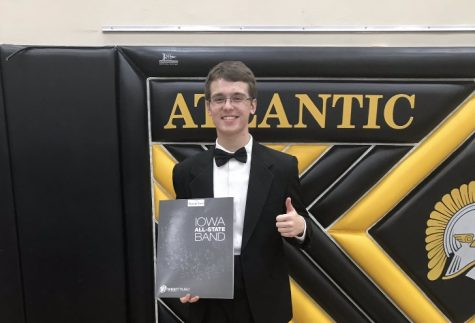 Junior Lex Somers poses with his All-State folder after receiving best of center his sophomore year. Somers will be auditioning for his third time on Saturday.