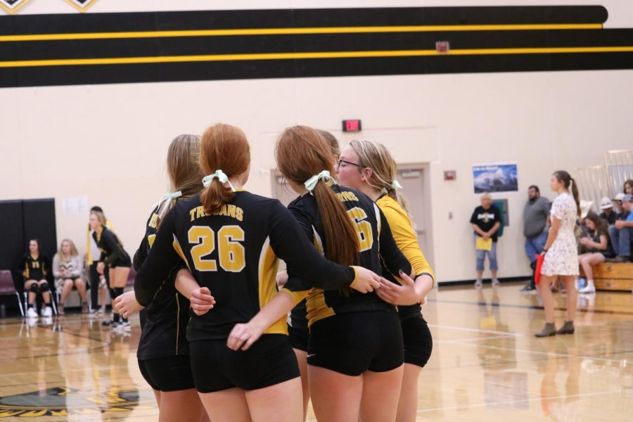 The freshmen volleyball team huddles after an exciting point. Smith plays on the varsity and freshmen teams.