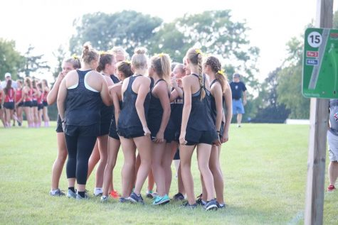 The girls cross country team huddles up after the Creston meet. Two freshmen run varsity this year.