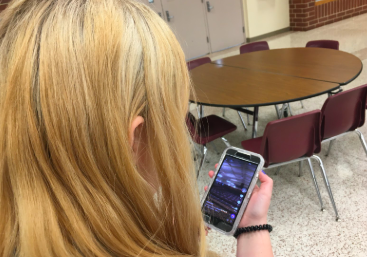 Junior Trista Flathers checks out the AHSneedle TikTok page.
