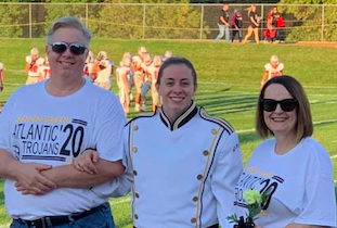 Senior Erin Barrick poses with her parents on Senior Night. She is the youngest child in her family.