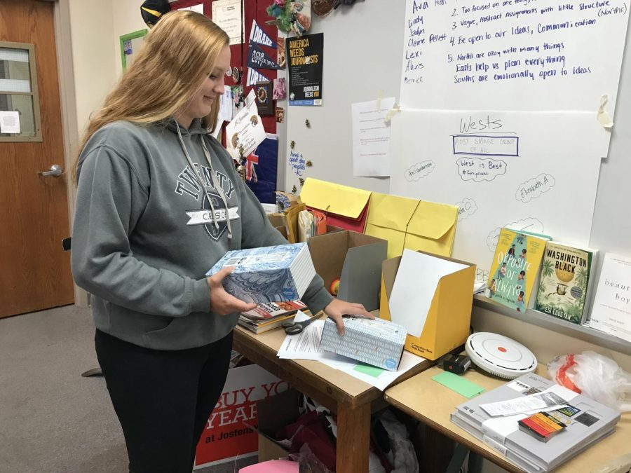 Junior Becca Folds distributes the tissues to classes around AHS. A variety of people sent in money or dropped of Kleenexes after her piece in the newspaper.