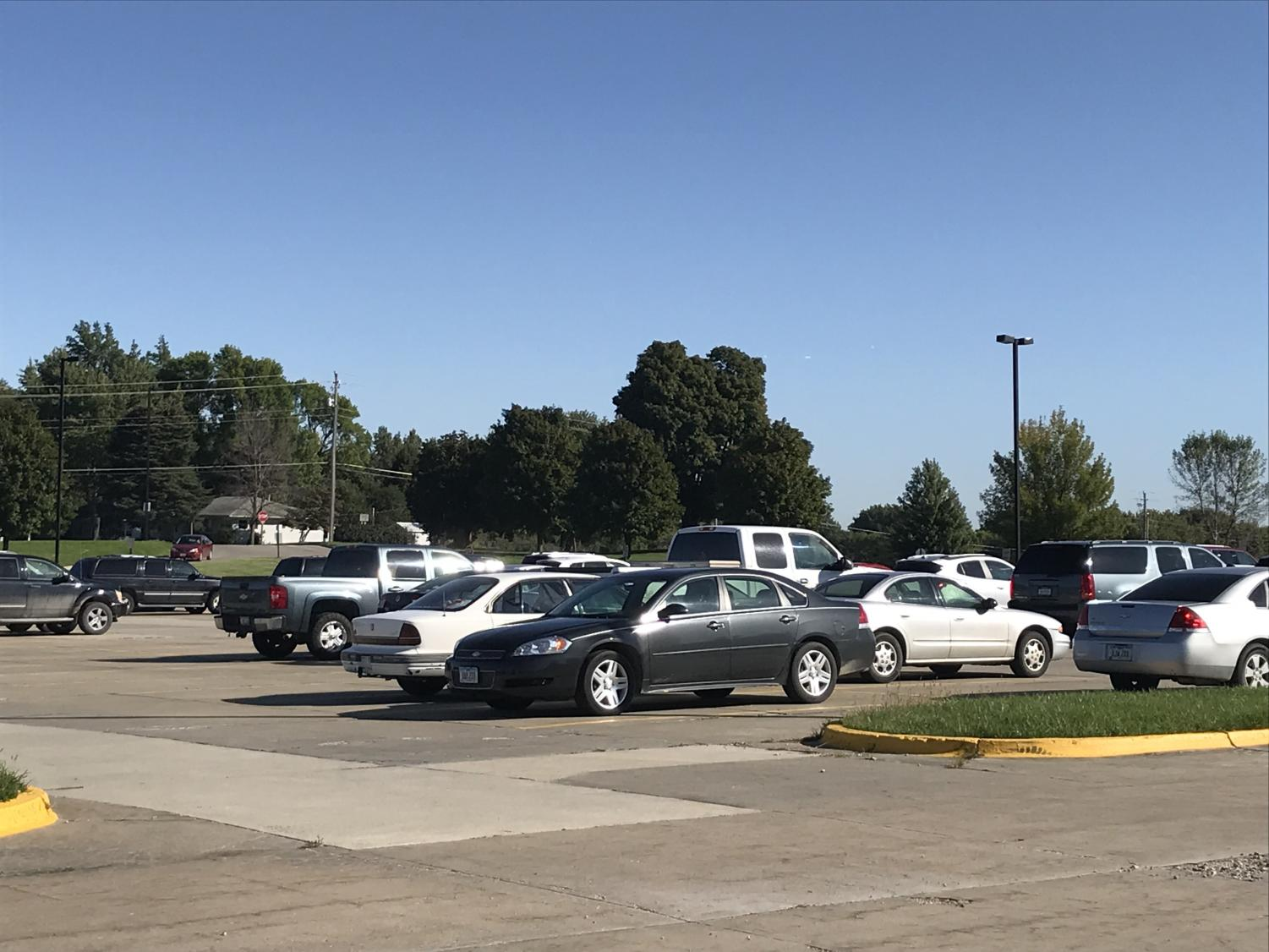 The AHS parking lot houses many vehicles during the school day.