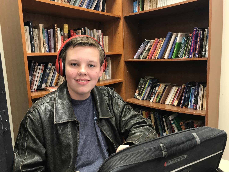 Sophomore Brycen Erickson tunes into his music during drama class. Erickson's headphones are bluetooth.