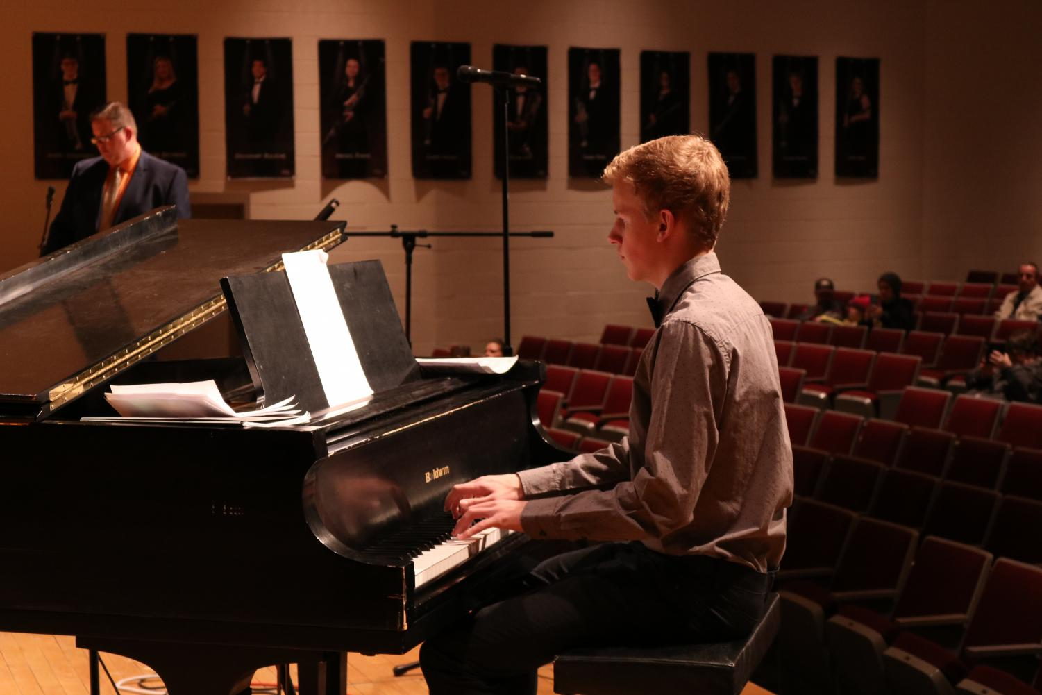 Senior Evan Brummer plays piano in the AHS Jazz Band. This year, the Jazz Band's compositions include a rendition of