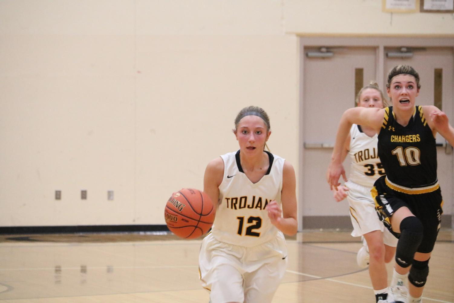 Junior Haley Rasmussen races down the court last season. Rasmussen has played on the varsity team since her freshman year.